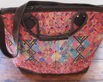 Beautiful travel/weekend bag. Made of vintage huipil fabric and chocolate suede.
