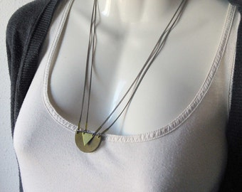 Geometric brass and leather necklaces. Leather necklace with a metal triangle. Multiple chain. Minimalist jewelry