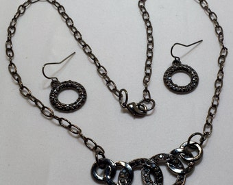 Black jeweled necklace and earring set.