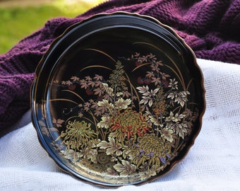 Pretty Japanese decorative dish with floral motifs and 1 dragonfly, in black.