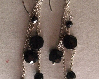 Silver earrings with bright Onix .