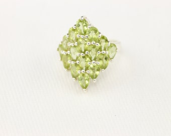 Bohemian Glamour! Pure sterling silver ring with green gems arranged in a cascading design!