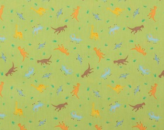 Ayako Kugimaru dinosaurs on green - Fat Quarter
