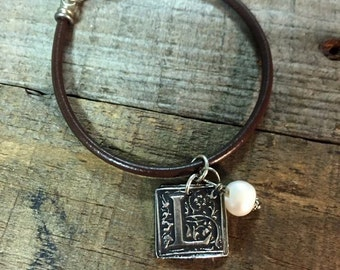 Leather bracelet with fine silver wax seal initial charm and freshwater pearl.