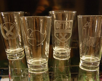 Etched Nerdfighter Glasses featuring the Nerdfighter Logo, DFTBA/Nerdfighteria, French the Llama and a Hanklerfish