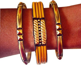 Jaime Bangle Trio in Brass Plated Metal with Orange Enamel Cable Accents and Milgrain and Rockstud Detail