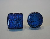 Asymmetric fused glass dichroic stud earrings in sparkling royal blue with gold tone posts and disc clutches
