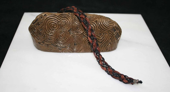 Celtic leather in black and browns