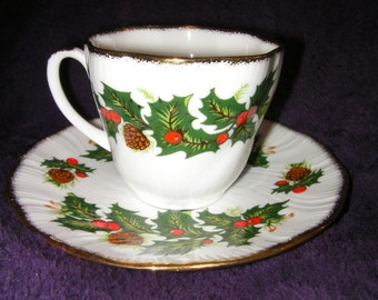 Vintage - Scalloped Gold Rimmed cup and saucer, by Queens Fine Bone China. Christmas hollies & Berries.