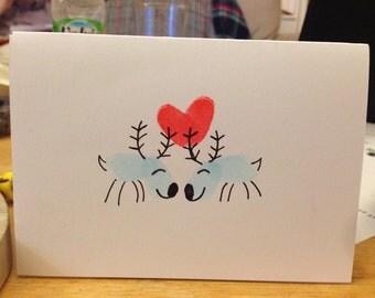 Handcrafted fingerprint reindeer Christmas card