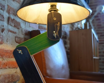 Articulated lamp in recycled skateboard