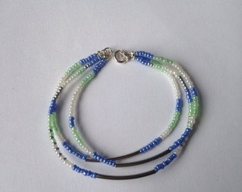 Bracelet adorned with rockeries beads and silver tubes - Friendship Bracelet.