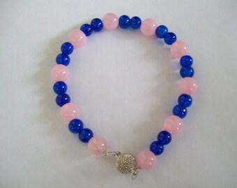 Light pink and dark blue bracelet