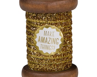 Gold Sparkle Ribbon on Wooden Spool