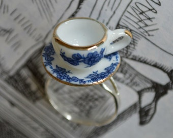 "Alice In Wonderland ""Curiouser and Curiouser"" Blue, White and Gold Tea Cup Ring."