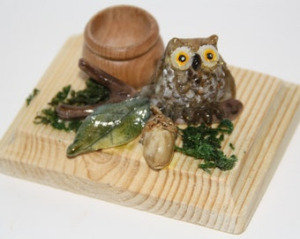 Candlestick with owl