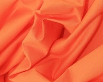 Orange 100% cotton fabric.