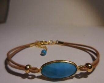 one big semi precious  stone  turquoise  color