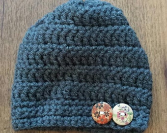 Crocheted baby hat with buttons
