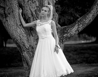 1950's style tea length wedding dress. Lace low backed bodice with open lace detail and full circle polka dot tulle skirt