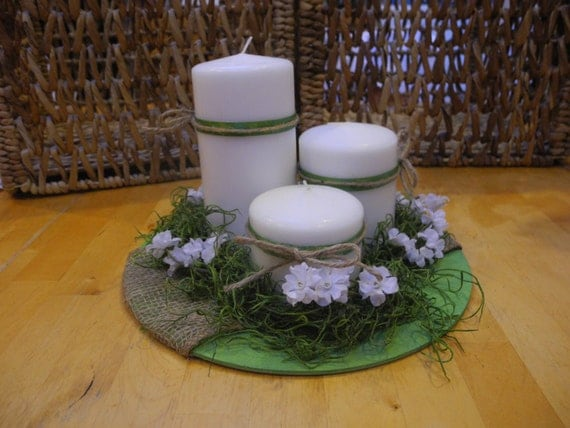 Spring centerpiece with three candles and white baby s