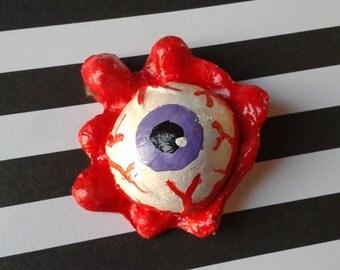Purple eyeball pin