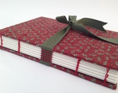 Notebook hand-stitched with waxed linen lined with 100% fabric thread cotton. Bound Coptic sewing and loop closure.
