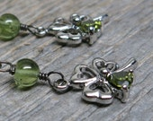 Lucky earrings ... antique silver four leaf clovers / dangly / peridot / crystal