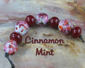 Lampwork Glass Bead Set ribbed rounds and rounds maroon orange green