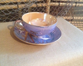 Vintage luster blue and gold  cup and saucer  good condition made in Japan