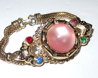 SJK Vintage -- Coro Signed Coroflex Gold Tone Bracelet with Pink Moonglow Cabochon and Jewel Tone Rhinestones (1950's-60's)