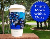 FREE SHIPPING UPGRADE with minimum -  Fabric coffee cozy / coffee cup holder / coffee sleeve  -- Bursts of Blue Flowers on Black