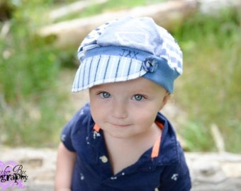 child sized Jax Hat inblues with stencil of Montana made from upcycled fabrics and handmade button - photos by Heatherbee