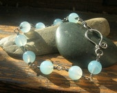 Translucent sky blue Chalcedony wire wrapped bracelet sterling silver 8 mm round brilliant blue beads