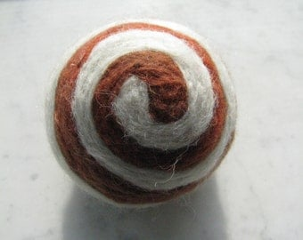 One multi-colored felted pin-cushion, Brown and White