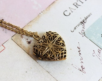 heart filigree. locket necklace. gold ox jewelry with a floral embossed back