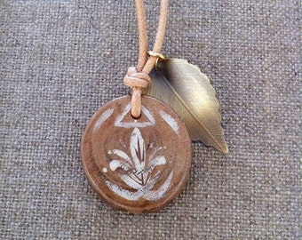 Faery Charm Necklace made from Casurina wood, hand painted with white paint and finished with a  golden leaf