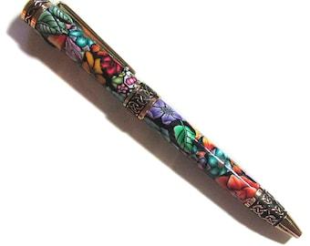 Elegant twist pen refillable black ink gold finish Millefiori floral polymer clay design nbr02