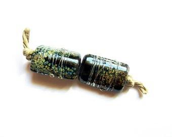 RAKU DUSTED JET    2 black, raku frit and metallic lustre kalera pair   A Beaded Gift