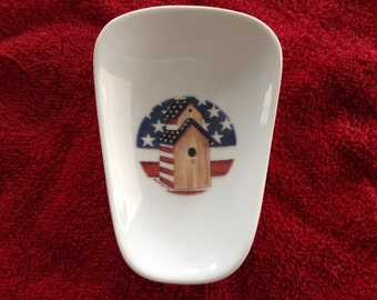 "Ceramic Spoon Rest with Amercaina  Double House. 5"" Long and 3 1/2 "" Wide On Top"