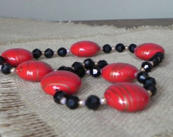 Vintage designer necklace red with gold stripes gold and black beads