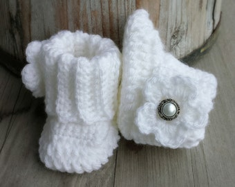 Crochet baby girl boots, in white with white flower and pearl button center. size 0 to 3 mo.