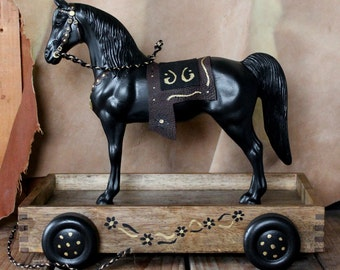 Breyer Horse pull toy - repainted black Breyer Western Horse on vintage style wooden wheeled cart, leather saddle, braided bridle art pony
