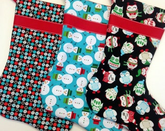 Set of Three Christmas Stockings in Black, Red, and Turquoise