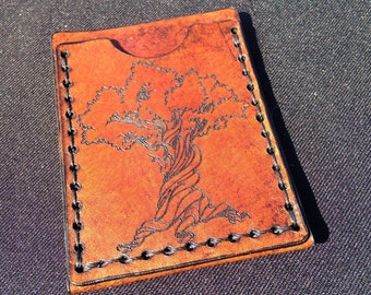 Leather card case with tree design
