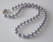FP  913 Necklace and earring set with Swarovski mauve pearls.