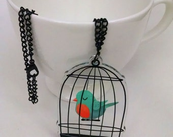 Caged Bird of Happiness clear acrylic charm necklace