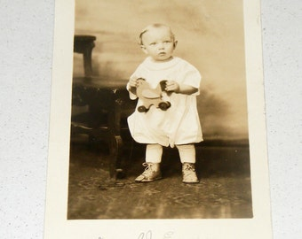 Antique RPPC Photograph Baby Donald Eugene holding Rooster Pull Toy postcard
