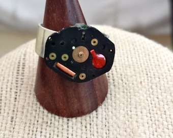 Cool Steampunk ring made from the inside components of a Bulova watch.  Steampunk Industrial black red and silver