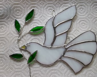 Snow white dove with branch